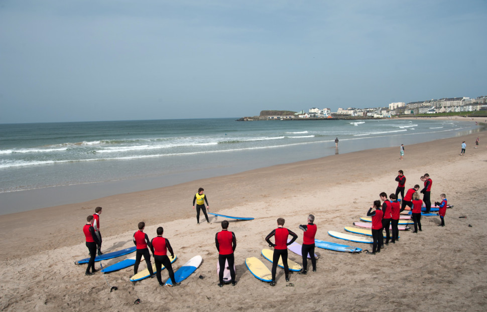 Surfing with Alive Surf School in Portrush Northern Ireland