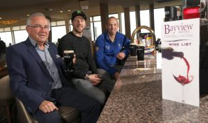 Trevor Kane, MD of The Bayview Hotel with riders from the Vauxhall International North West 200. The hotel is sponsoring the Thursday night race.
