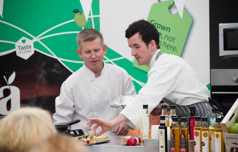 Dean Coppard with chef Liam McEvoy cooking at the Richhill Apple Harvest Fayre. RAHF-5277