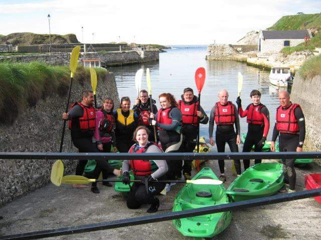 A happy bunch of kayakers with Causeway Coast Kayaking Tours