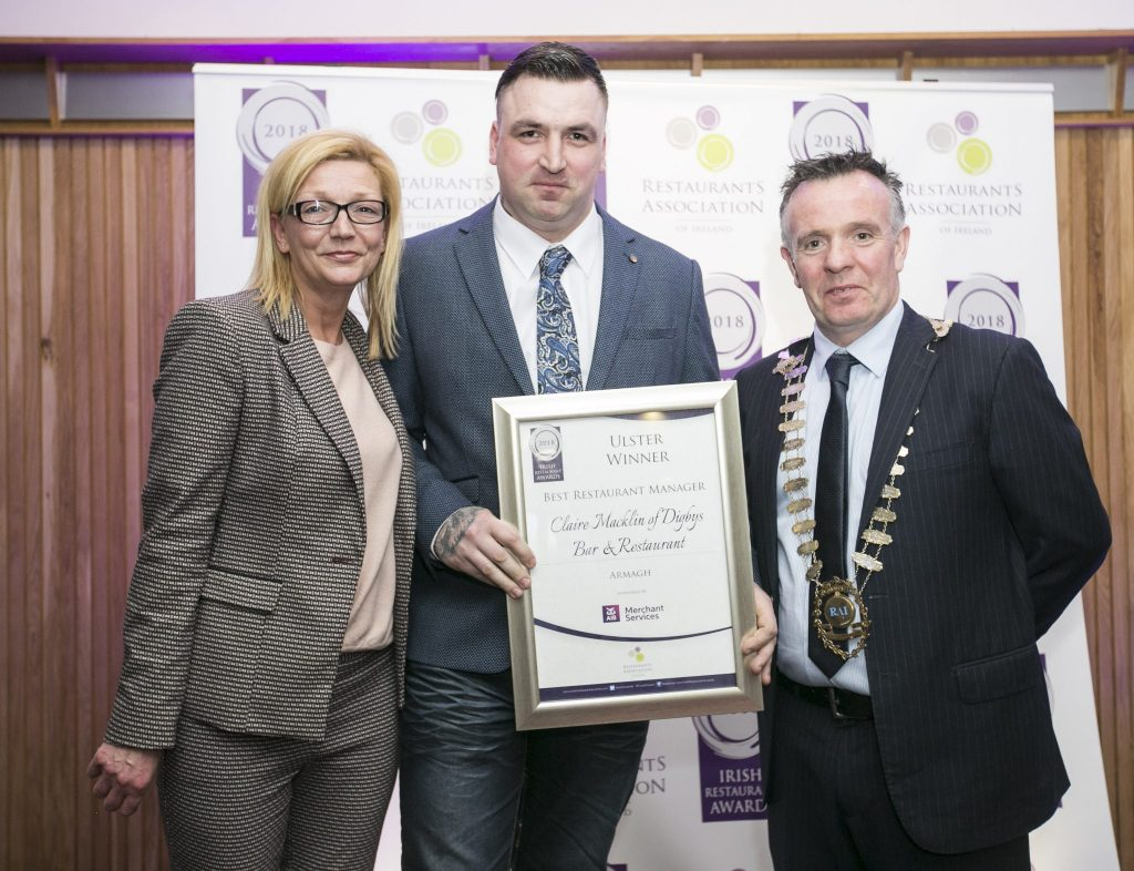 Edgars Ratniks picking up Claire Macklin's award at the irish Restaurant Awards Ulster Regional Finals 2018