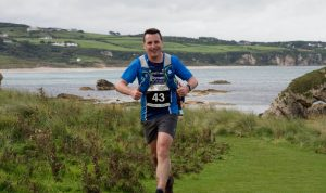 Jonny Graham running on the Causeway Coastal Path - Born To Run Tours