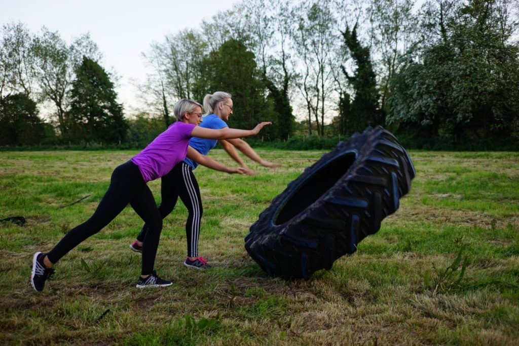 Fit Farm Camp - Tyre flipping on a fam in County Tyrone with Live It Experience It member Go Fitness NI