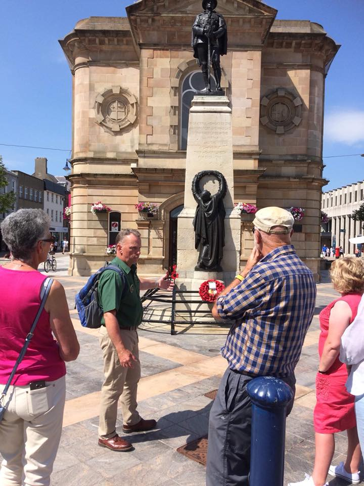 Ray Boal taking tourists on a walking heritage tour of Coleraine for Dalriada Kingdom Tours