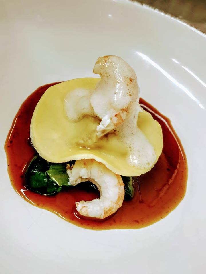 Hand rolled raviolli, rabbit, cherry and rabbit jus, wilted spinach, poached langoustine, clam foam